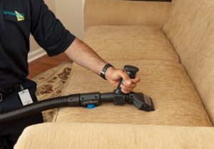 Technician cleaning a couch in Middlesex County